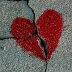 Chalk heart drawn over a crack in the sidewalk