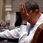Obama palms his face under stress