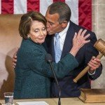 Boehner hugs and kisses Pelosi on the cheek while holding gavel