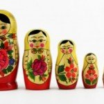 Nesting dolls lined up in order from biggest to smallest