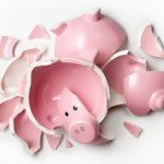Pink piggy bank smashed into several pieces