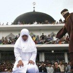 Woman in white hijab is canned by masked person by form of punishment
