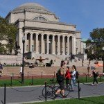 Angled view of Columbia University and students walking to and from campus