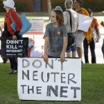 Young child holds sign at protest that reads Don't Neuter the Net