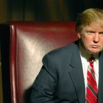 Donald Trump sits in red chair for NBC series The Apprentice