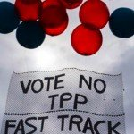 Red and black balloons on sign that reads Vote No TPP Fast Track