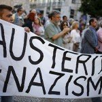 Protestors hold banner that reads Austerity = Nazism