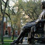Side view of John Harvard statue