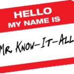 Red and white nametag reads Hello My Name Is Mr. Know-It-All