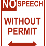 Red and white road sign reads No Speech Without Permit