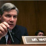 Politician Sheldon Whitehouse at conference with name plaque