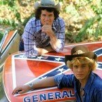 Actors pose with car with confederate flag on roof