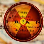 Map of Iran with red and yellow nuclear warning sign
