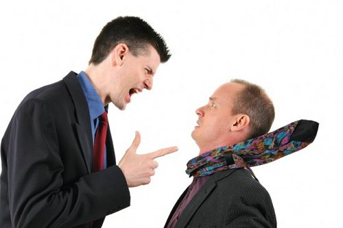Man yelling and pointing at another man