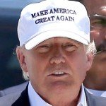 Donald Trump wearing a white hat reads Make America Great Again