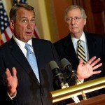 John Boehner speaks with Mitch McConnell in background