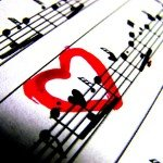 Sheet music with a red heart drawn over music notes