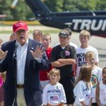 Donald Trump gives speech as young kids stand in background