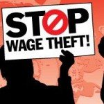 Silhoette holds sign that reads Stop Wage Theft!