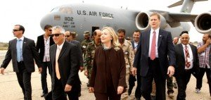 U.S. Secretary of State Hillary Rodham Clinton walks from  her C-17 military transport upon her arrival in Tripoli  Libya, Tuesday Oct. 18, 2011. The Obama administration on Tuesday increased U.S. support for Libya's new leaders as Secretary of State Hillary Rodham Clinton made an unannounced visit to Tripoli and pledged millions of dollars in new aid, including medical care for wounded fighters and additional assistance to secure weaponry that many fear could fall into the hands of terrorists.  (AP Photo/Kevin Lamarque, Pool)