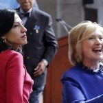 Huma Abedin, left, an aide to Hillary Rodham Clinton, watches the Democratic presidential contender greet members of the audience following a speech at the David N. Dinkins Leadership and Public Policy Forum, Wednesday, April 29, 2015. in New York. David Dinkins is at center. (AP Photo/Mark Lennihan)