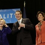 """Former Secretary of State Hillary Rodham Clinton, left, New York Governor Andrew Cuomo and Lt. Governor nominee Kathy Hochul laugh on stage during a """"Women for Cuomo"""" campaign event in New York, Thursday, Oct. 23, 2014.  Mrs Clinton is backing Cuomo in his bid for a second term.  Cuomo faces Republican Westchester County Executive Rob Astorino in the Nov. 4 general election. (AP Photo/Seth Wenig)"""