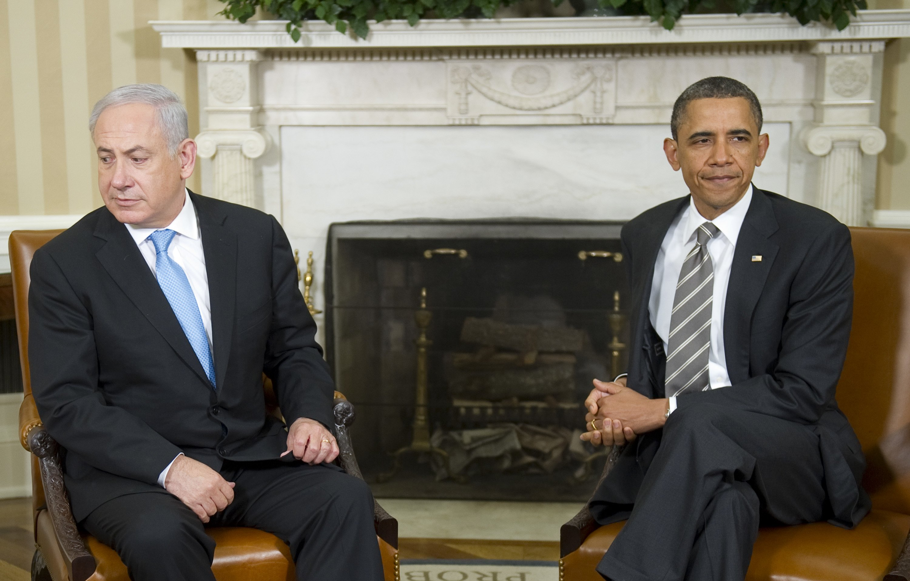 "TOPSHOTS US President Barack Obama (R) meets with Israeli Prime Minister Benjamin Netanyahu in the Oval Office of the White House in Washington, DC, May 20, 2011. Obama announced on Thursday in his long-awaited speech on the ""Arab Spring"" revolts that territorial lines in place before the 1967 Arab-Israeli war should be the basis for a peace deal, a move Netanyahu has long opposed.    TOPSHOTS / AFP PHOTO / Jim WATSON (Photo credit should read JIM WATSON/AFP/Getty Images)"